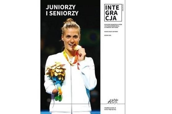 Okładka magazynu Integracja. Na okładce zdjęcie Natalii Partyki, gryzącej swój złoty medal oraz napis: Juniorzy i Seniorzy